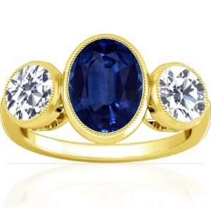 14K Yellow Gold Oval Cut Blue Sapphire Three Stone Ring