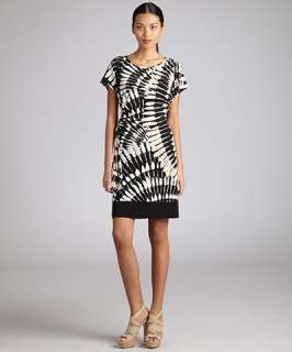 Donna Morgan black and tan printed jersey cap sleeve side knot dress
