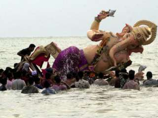 Idol of Hindu Elephant Headed God Ganesh into the Arabian Sea, Bombay