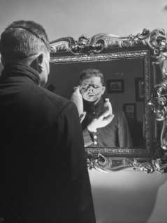 Cartoonist Charles Addams Experimenting with Scary Faces for His