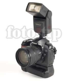 En la foto podemos ver la cámara Nikon pero el objeto de la auccion