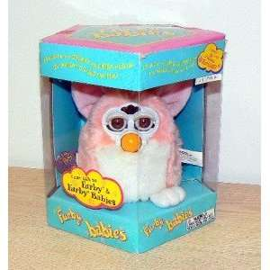 : PINK AND WHITE W/ YELLOW MOHAWK PEACH FURBY BABY 1999: Toys & Games